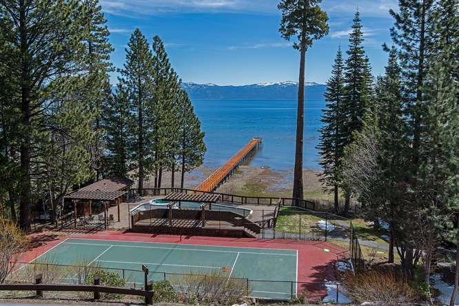 View from the condo of HOA Tennis Courts, Pool, Extended Pier and Lake