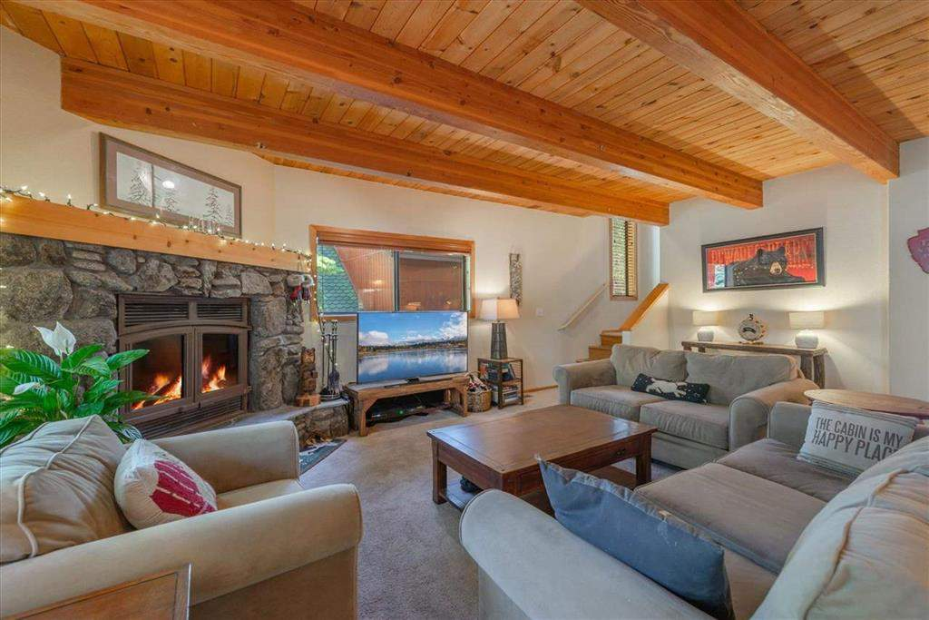 Spacious living room with wood fireplace   12136 Brookstone Drive