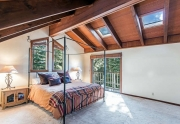 Master Bedroom Featuring Vaulted Ceilings