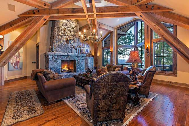 Breathtaking Great Room with Picture Windows and Floor to Ceiling Stone Fireplace | Northstar Luxury Lodge