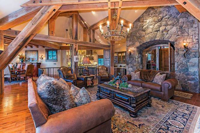 Breathtaking Great Room with Picture Windows and Floor to Ceiling Stone Fireplace | Homes for Sale Lake Tahoe