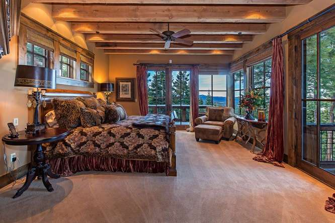 Majestic Master Bedroom with numerous picture windows framing Sierra Crest views | Martis Valley Real Estate