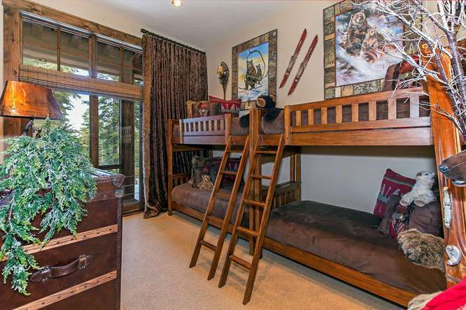 Kids Guest Bedroom featuring four bunks and a private en suite bathroom | Tahoe Luxury Home