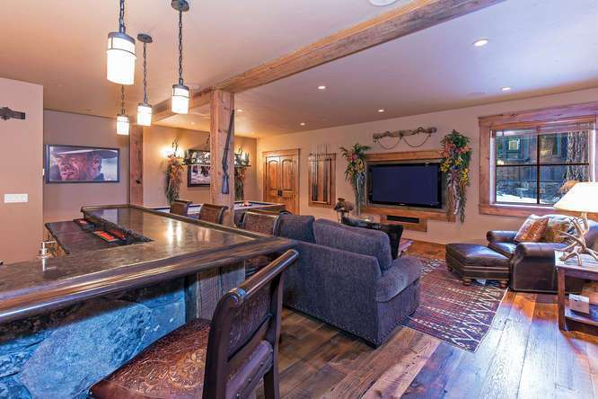 Saloon featuring bar, pool table, media area and bathroom | Northstar Real Estate