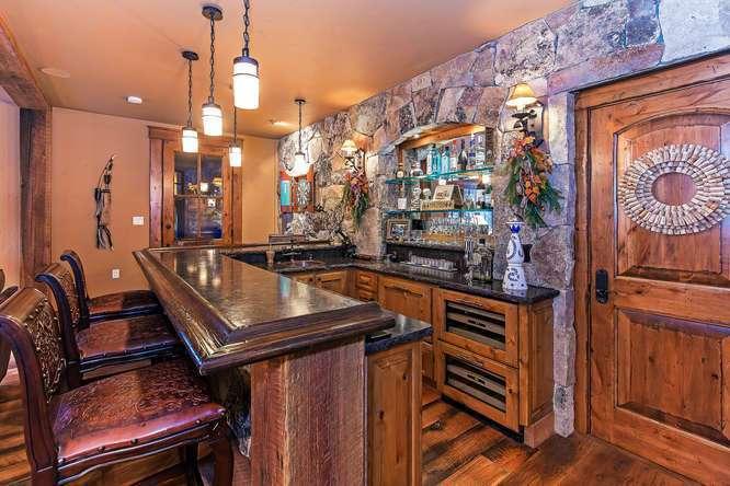 Saloon featuring bar, pool table, media area and bathroom | Northstar Luxury Lodge