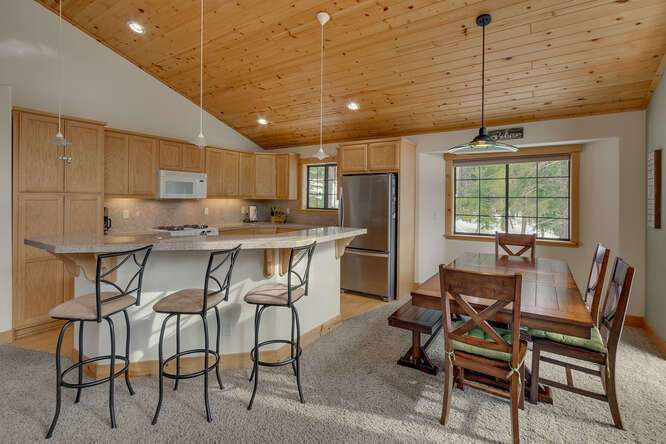 Open concept kitchen and dining | 12259 Northwoods Blvd