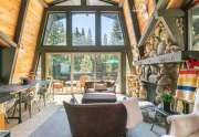 Gorgeous living room with picture windows | Alpine Meadows Home