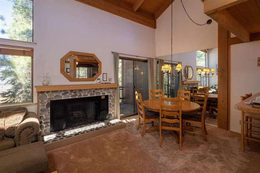 Living room with rock fireplace | Rare Northstar Townhome