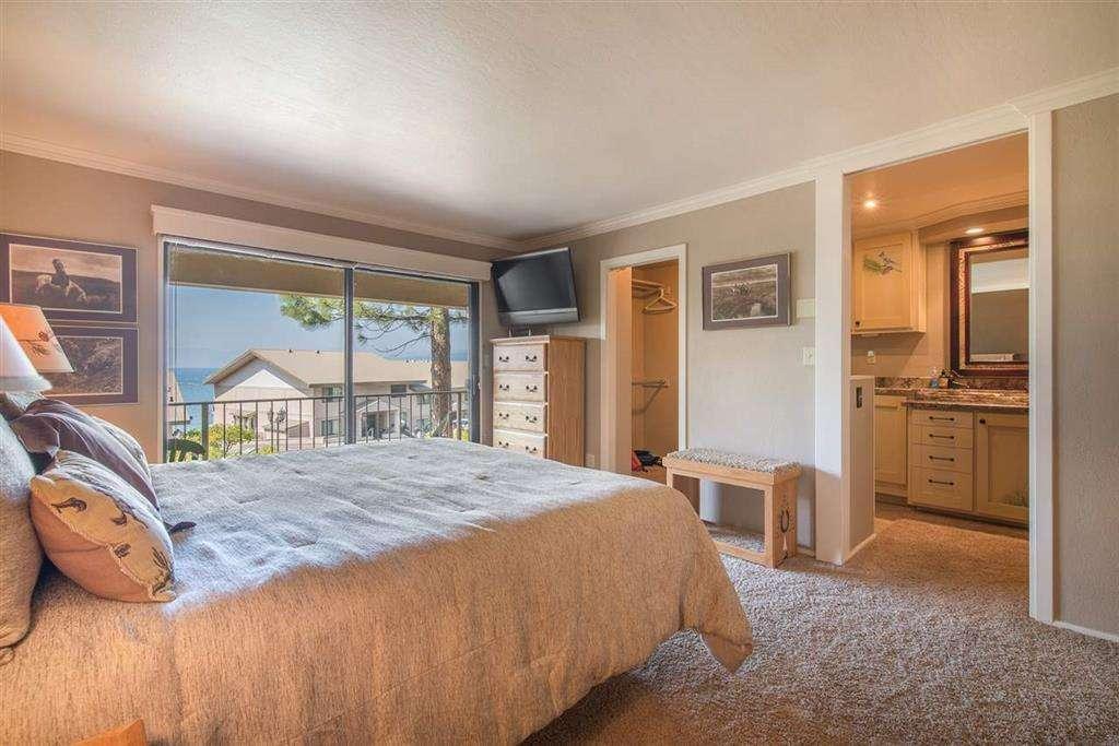 Lake Tahoe Condo | 7580 North Lake Blvd | Bedroom with Lake Tahoe View