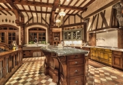 the-chefs-kitchen-has-hand-carved-wooden-beams-and-its-own-fireplace