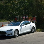 Tesla Model S Charging at Oliver Luxury Real Estate