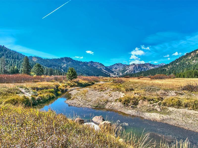 325 Squaw Valley Rd | Squaw Valley home for sale image, stream with mountains behind