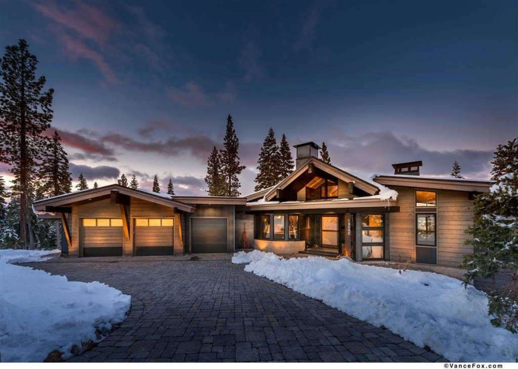 19040 Glades Place | Truckee Luxury Real Estate, image of beautiful truckee home for sale with sunset behind, snow on the ground