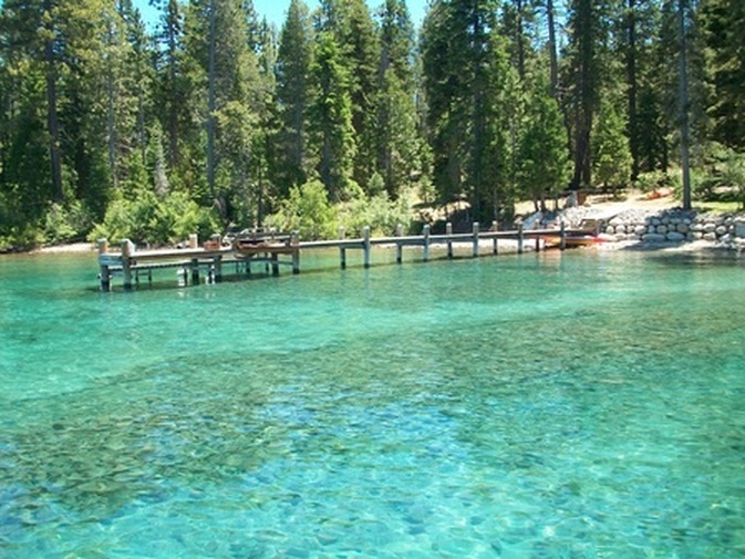 135 Quiet Walk Road | Tahoma Luxury Real Estate, image of clear lake tahoe and pier with trees in the background