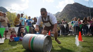 Image of man roling a keg at Squaw Valley Oktoberfest for Top Fall Events in North Lake Tahoe blog post