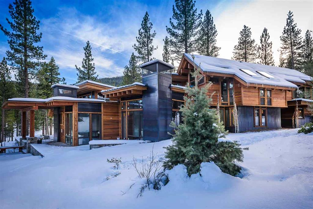 2401 Newhall Court | Truckee Luxury Homes, image of snow covered truckee home for sale with clouds in the sky