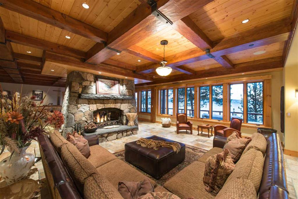 1780 North Lake Blvd | Lake Tahoe Luxury Home, tahoe city home for sale image of inside woodwork and view through windows with fireplace